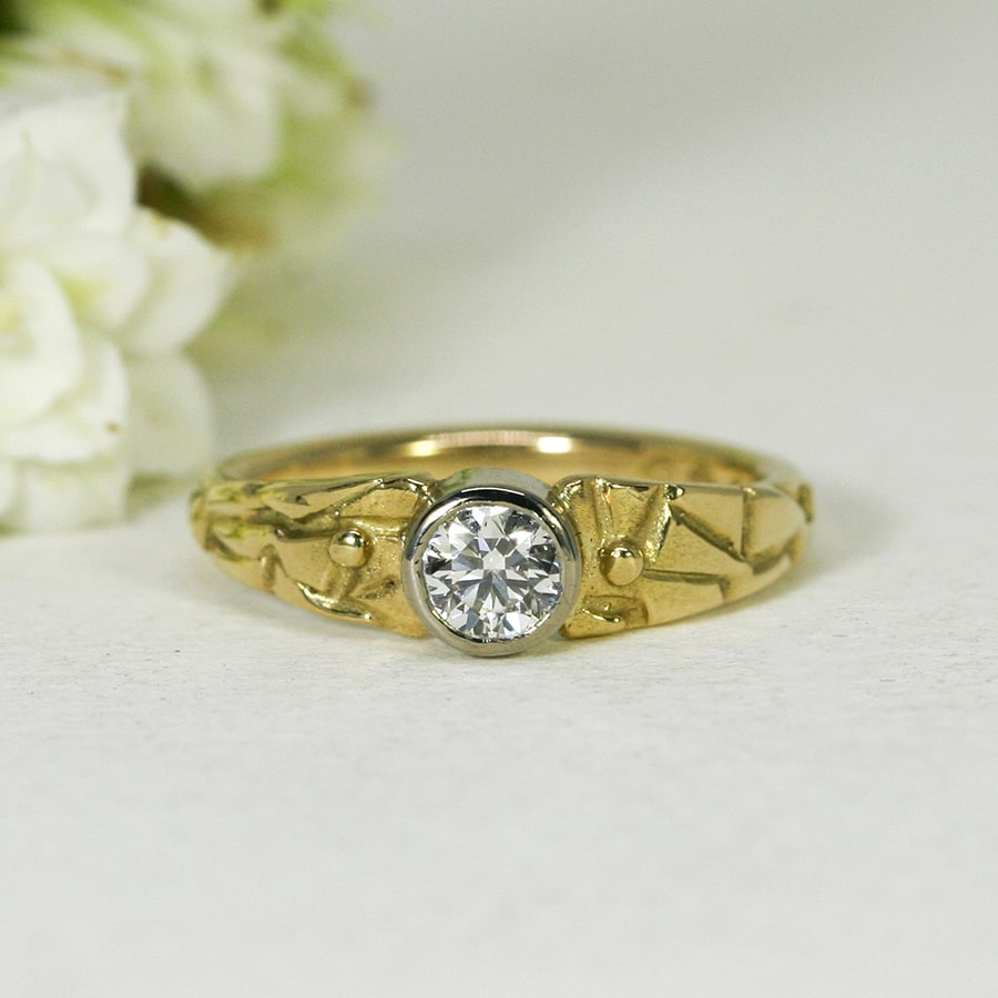 'Adamaris', 18ct fused Yellow Gold band and 18ct White Gold bezel set with 43pt Diamond