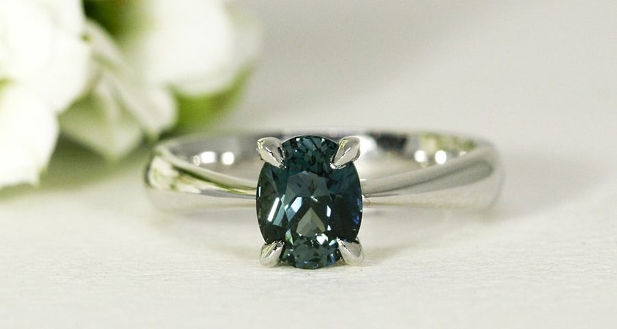 'Ocean Deep', 18ct White and Rose Gold Ring set with Teal Green 1.53ct Sapphire