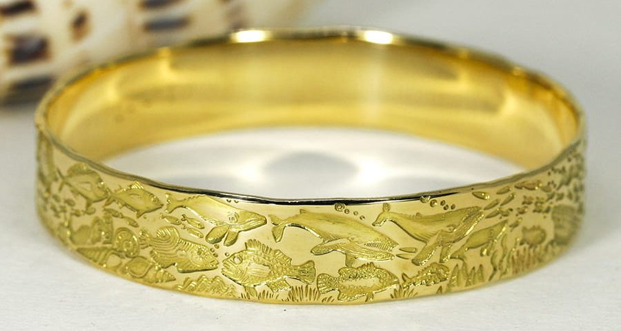 'Oceans of the Universe', 18ct Yellow Gold bangle with an Underwater story theme
