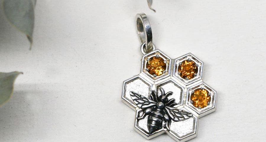 Bee and Honeycombe pendant, set with three Citrine stones