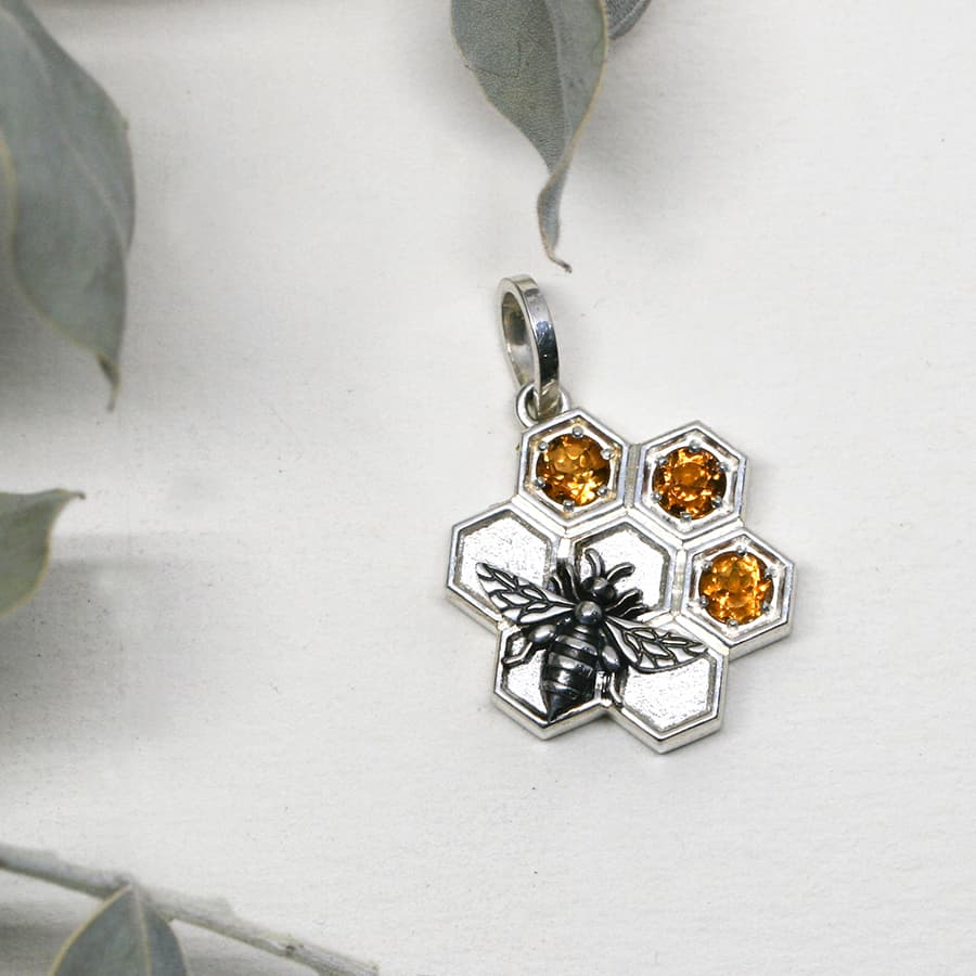 Bee and Honeycombe pendant, set with three Citrine stones