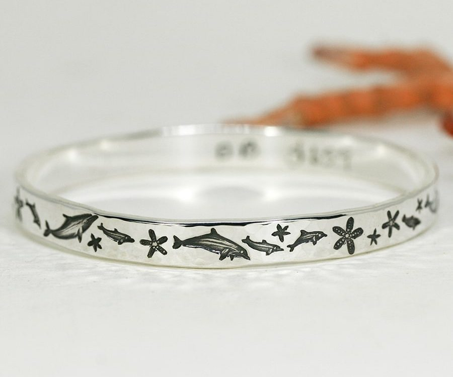 'Dolphin Beat', narrow bangle with beaten finish