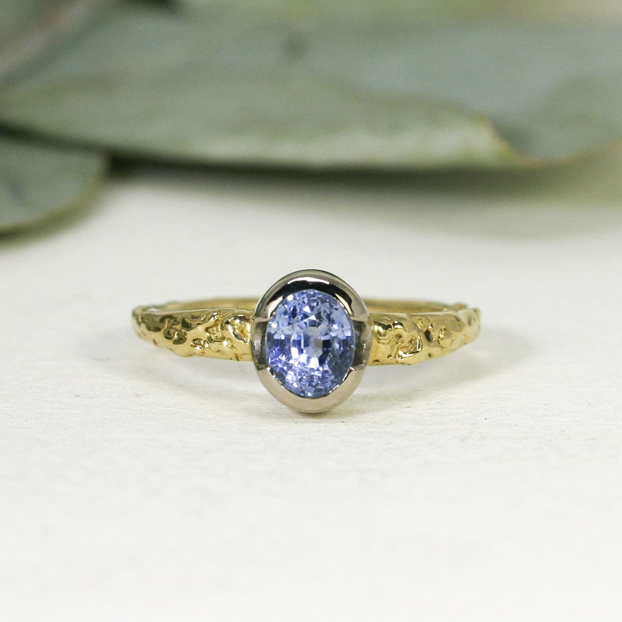 'Daylight Dreaming', 18ct Fused Yellow Gold band and 18ct White Gold Bezel set with a 1.51ct Cornflour Ceylon Sapphire