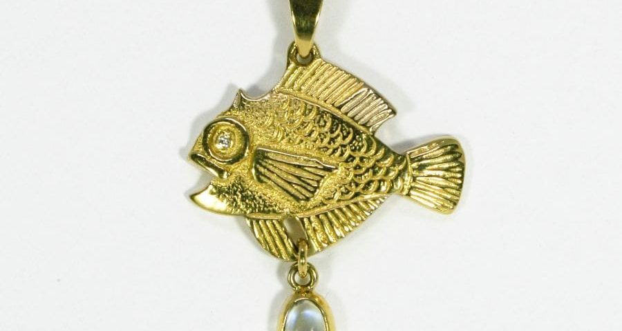 'The Golden Fish', 18ct fused Gold pendant with a Diamond set in the eye and Moonstone drop