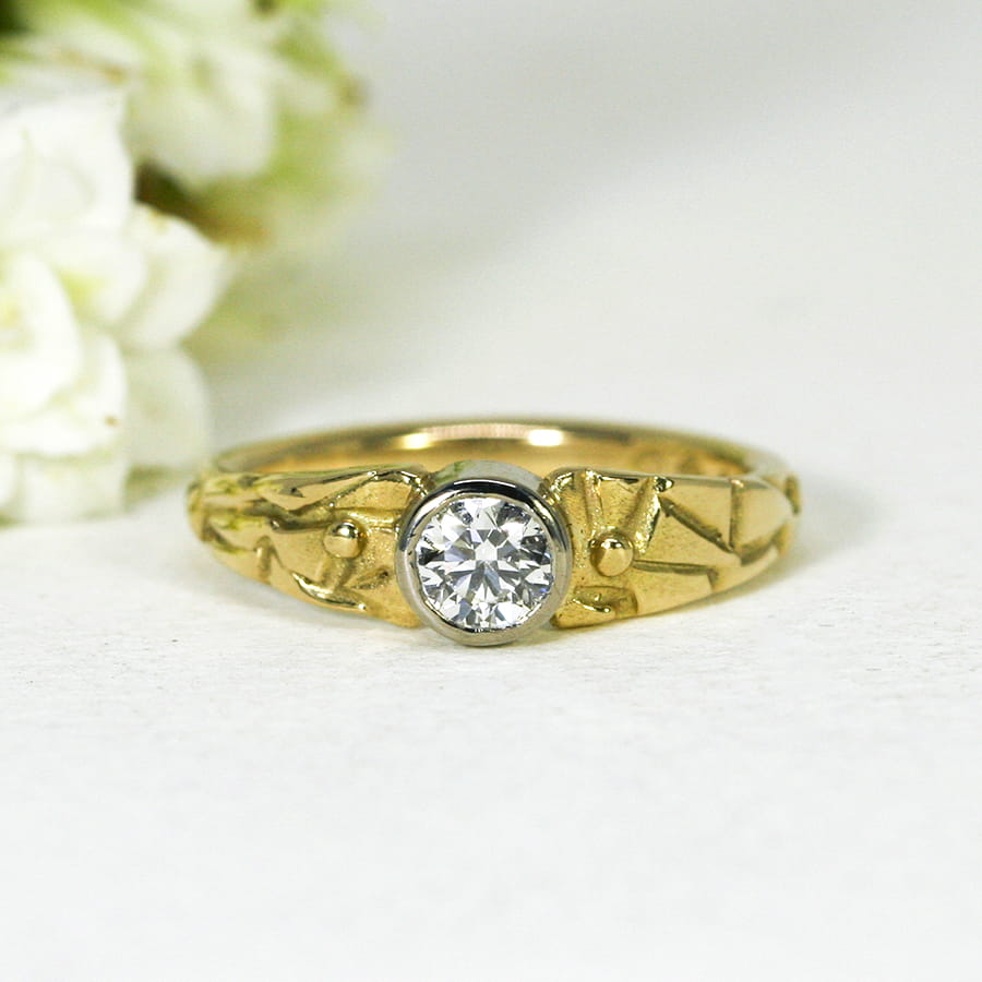 1. 'Adamaris', 18ct fused Yellow Gold band and 18ct White Gold bezel set with 43pt Diamond