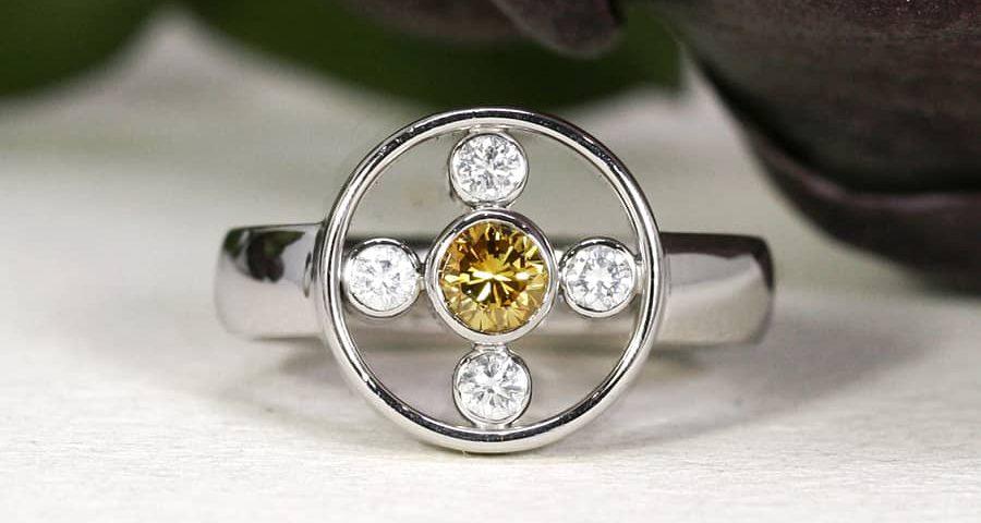 11. 'Golden Orbit', 18ct White Gold, set with 28pt Yellow Diamond and 4 x 4pt EVS Diamonds