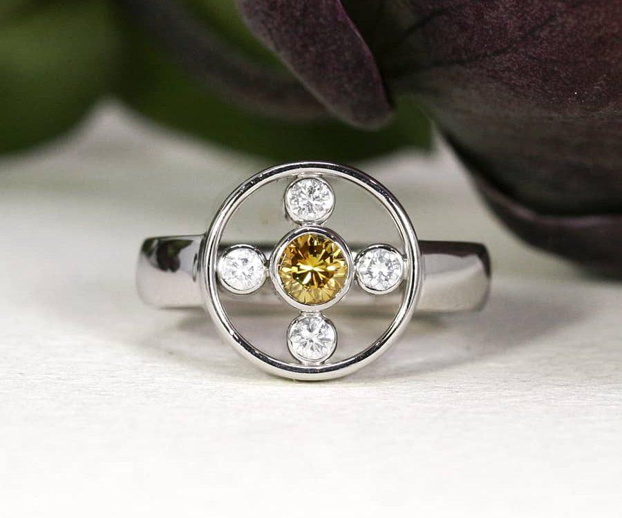 11. 'Golden Orbit', 18ct White Gold, set with a Yellow Diamond and 4 x 4pt EVS Diamonds