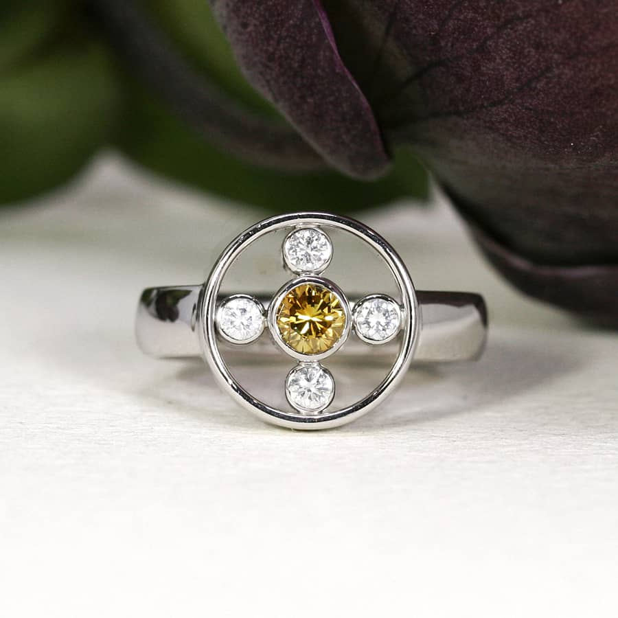 11. 'Golden Orbit', 18ct White Gold, set with a Yellow Diamond and 4 x 4pt EVS Diamonds