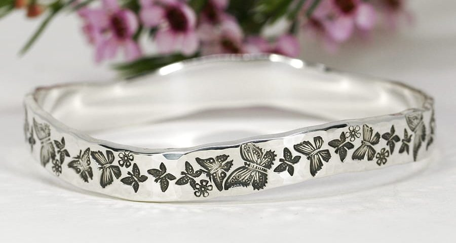 14. 'Butterfly Beauty', Sterling silver bangle with wave and beaten finish