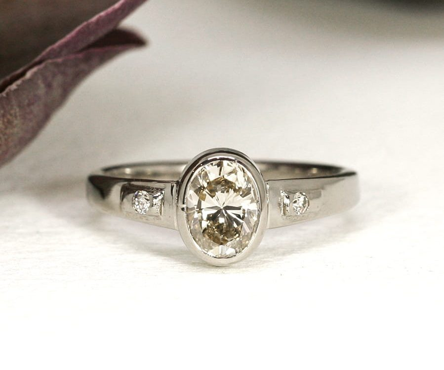 15. Kahlua Creme', 18ct White Gold, set with 1.06ct Cognac Diamond and two 0.06ct Diamonds