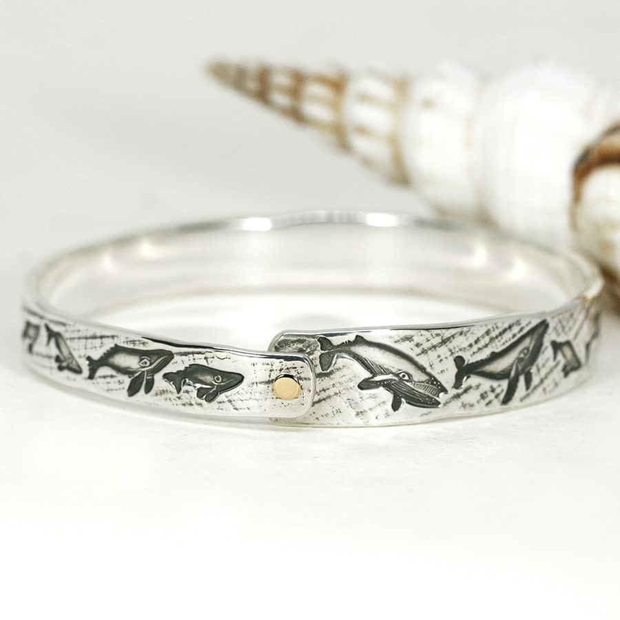 16. 'Humpback Gold', Sterling silver bangle with 18ct yellow gold rivet