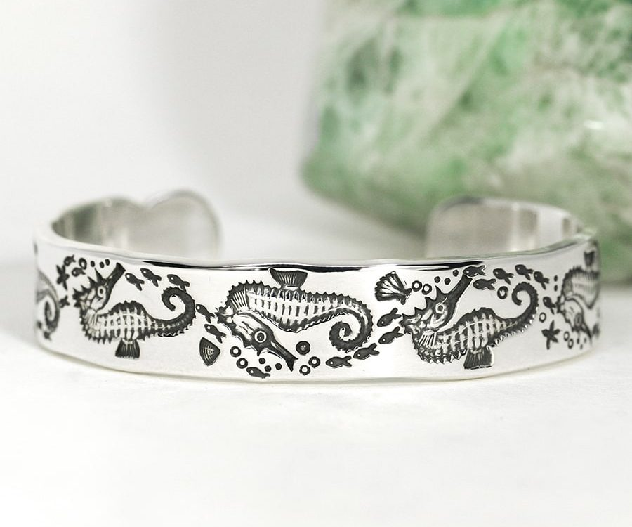 17. 'Seahorse Swim', sterling sivler cuff with scalloped details on the ends