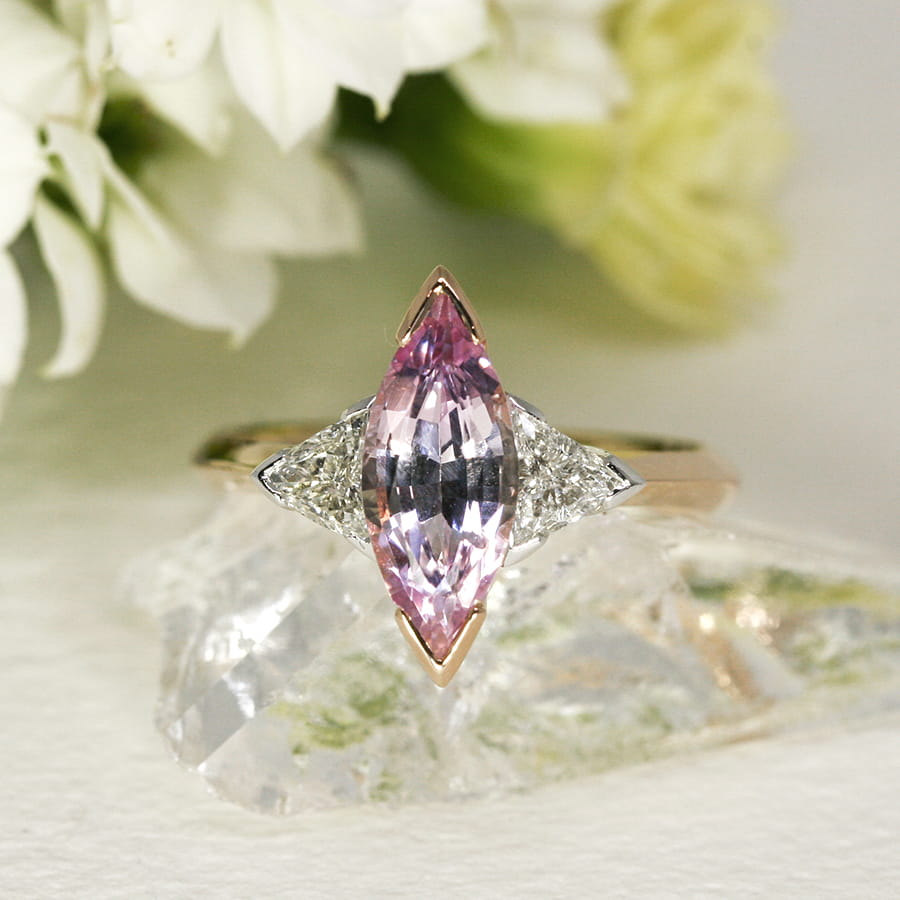 19. 'Magic', 18ct Rose and White Gold, set with a 1.86ct Pink Sapphire and two 0.38ct Diamonds