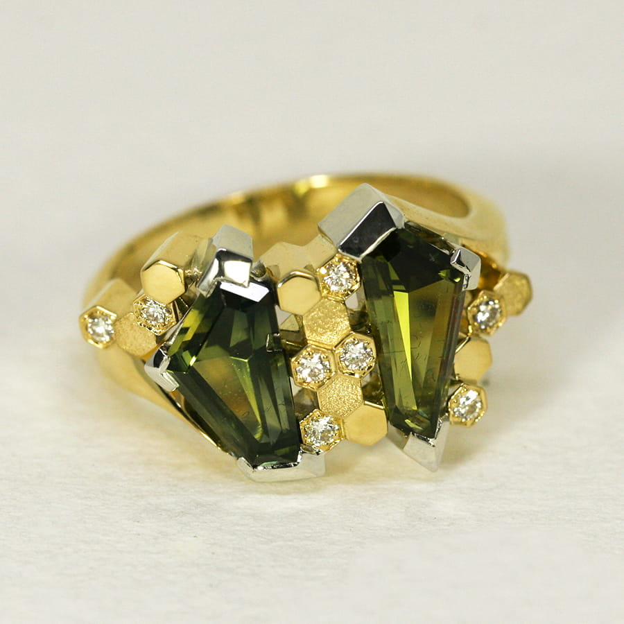 20. 'Manuka', 18ct White and Yellow Gold, set with two Australian Green Sapphires totalling 2.93cts and eight Diamonds totalling 0.12cts