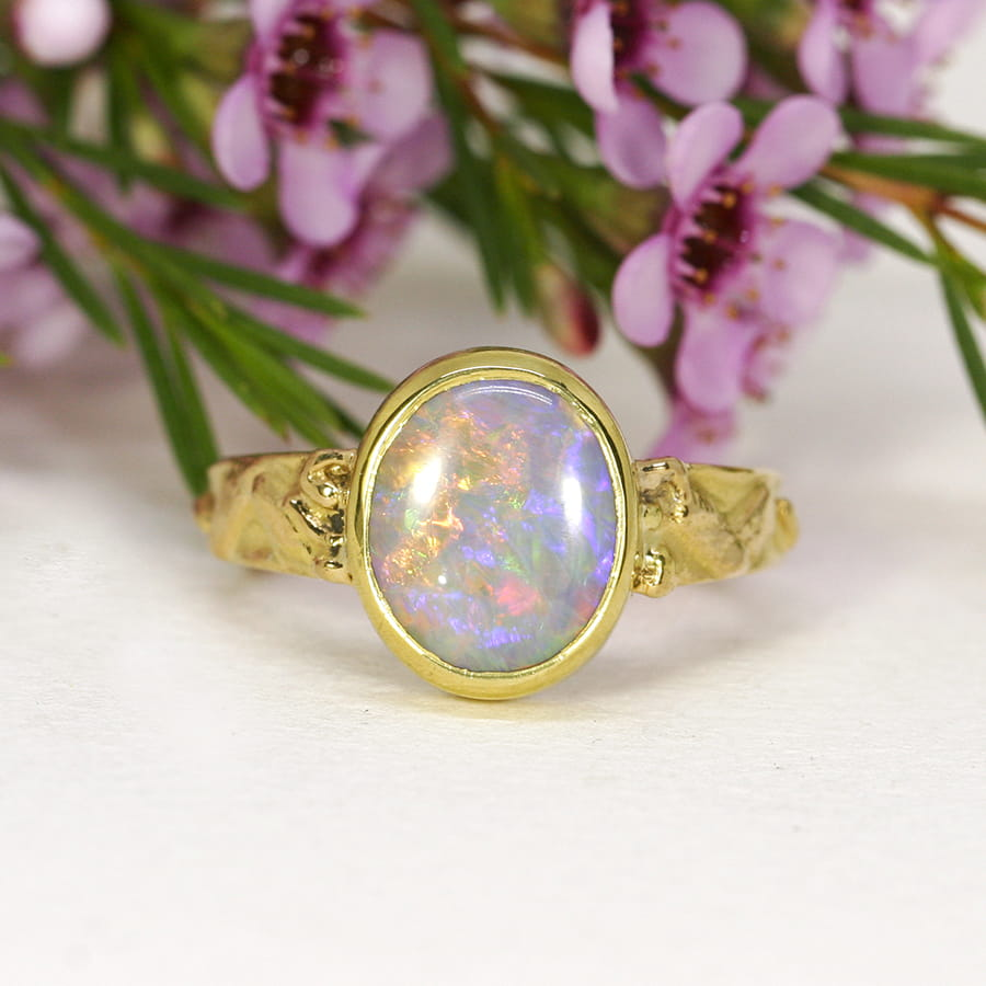 23. 'A Ring For Monet', 22ct Yellow Gold, set with a 4ct Semi-Black Opal