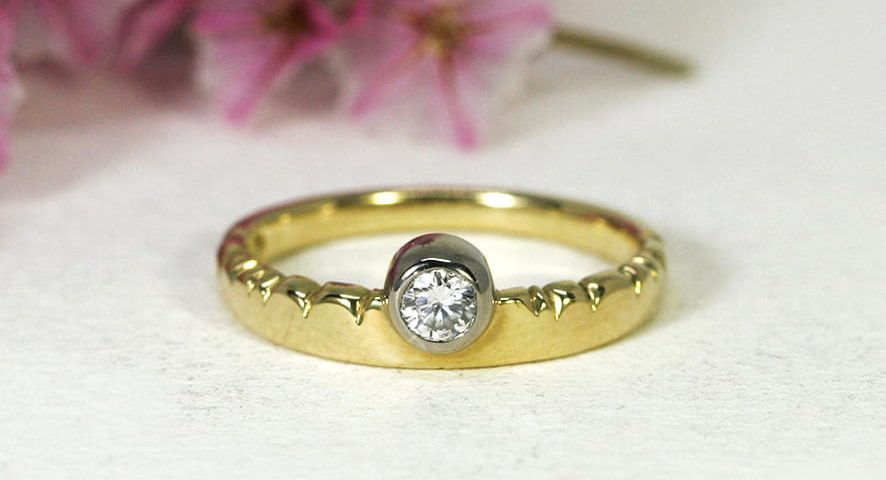 5. 'Golden Cloud', 18ct Yellow Gold Band with 18ct White Gold Bezel, set with a 15pt Diamond
