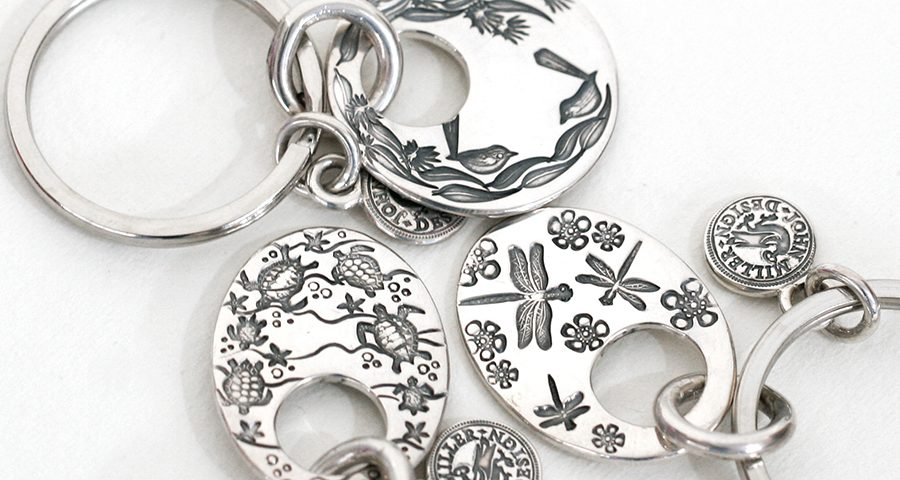 keyrings, stamped with various designs