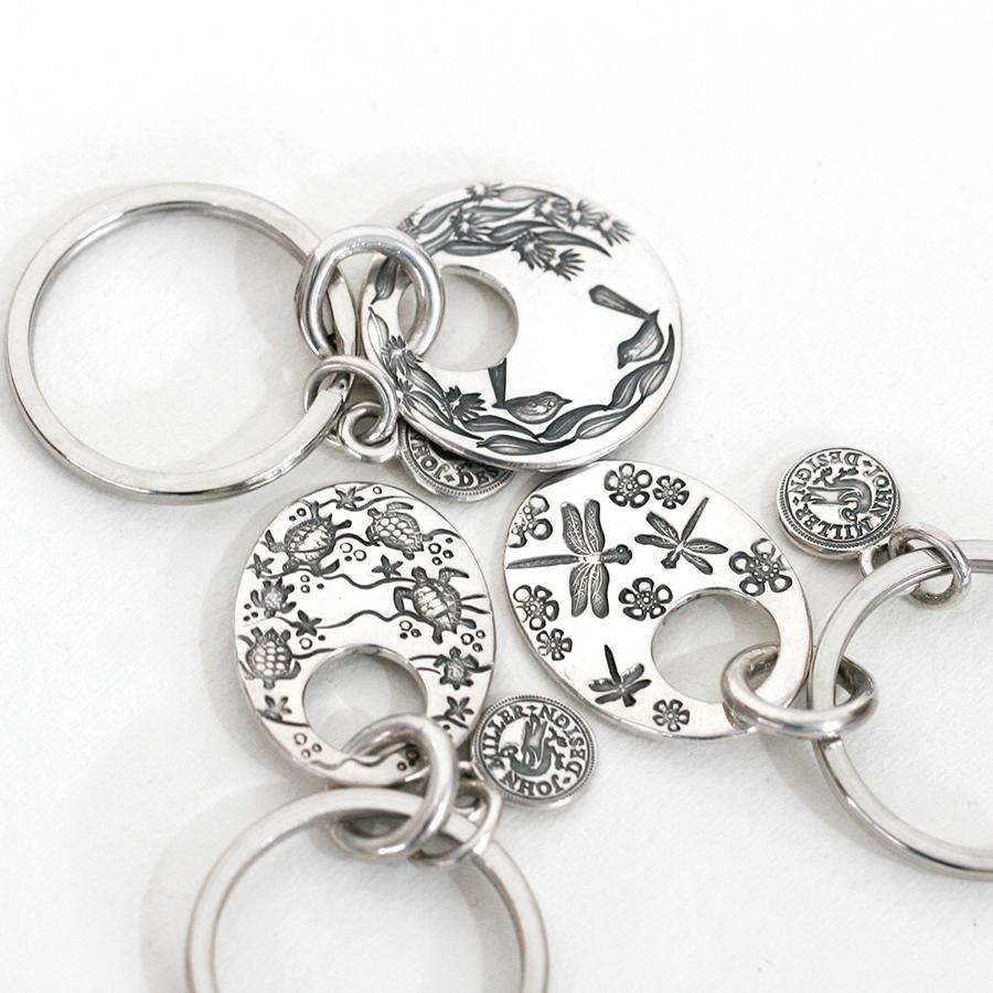 keyrings, stamped with various designs