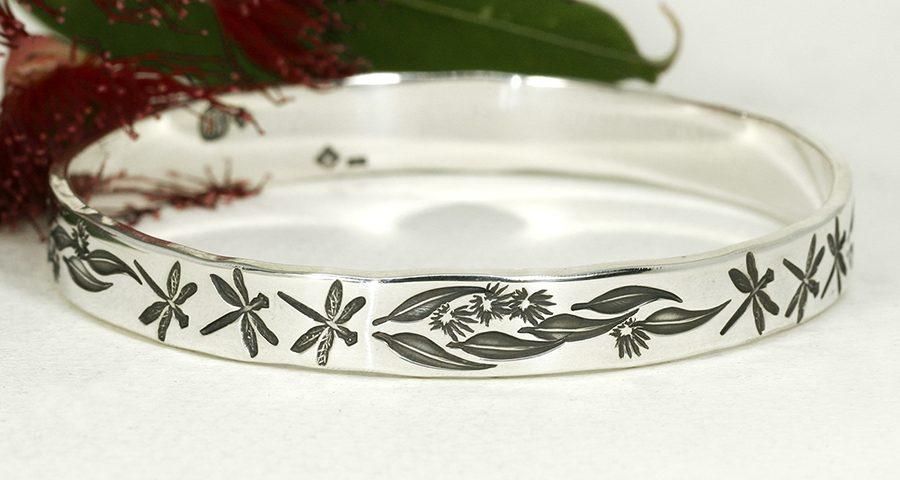 Dragonfly-Blossom-sterling-silver-handcrafted-bangle-featuring-dragonflies-gumleaves-blossom-john-miller-design