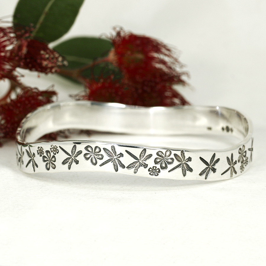 Marrinup Garden sterling silver handcrafted bangle featuring dragonflies flowers
