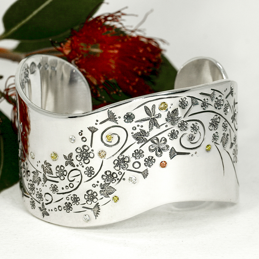 Everlasting-summer-wide-sterling-silver-cuff-with-hand-engraved-detail-set-with-assorted-coloured-diamonds-john-miller-design