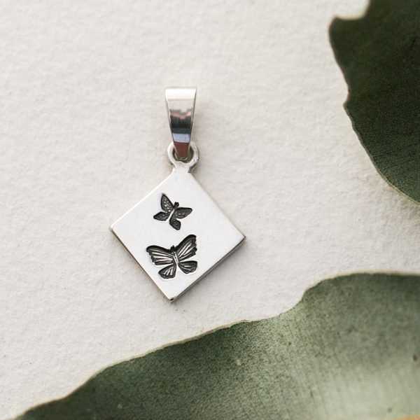 Sterling silver small diamond shaped butterfly pendant