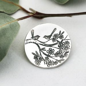 Sterling silver round pendant with wren on branches