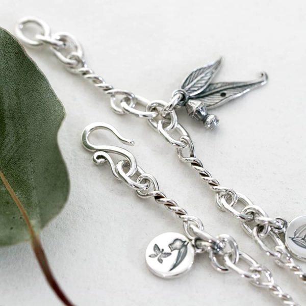 Sterling silver gumleaf charm bracelet up close