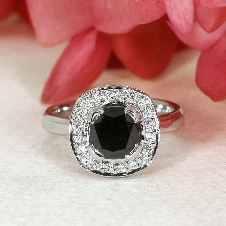 'Beautiful in Black' 18ct white gold ring with black diamond in centre 48 small white diamonds handcrafted john miller design