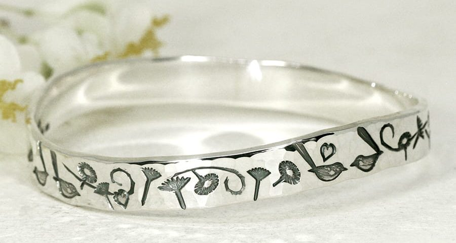 Everlasting Wrens sterling silver bangle with a wave profile