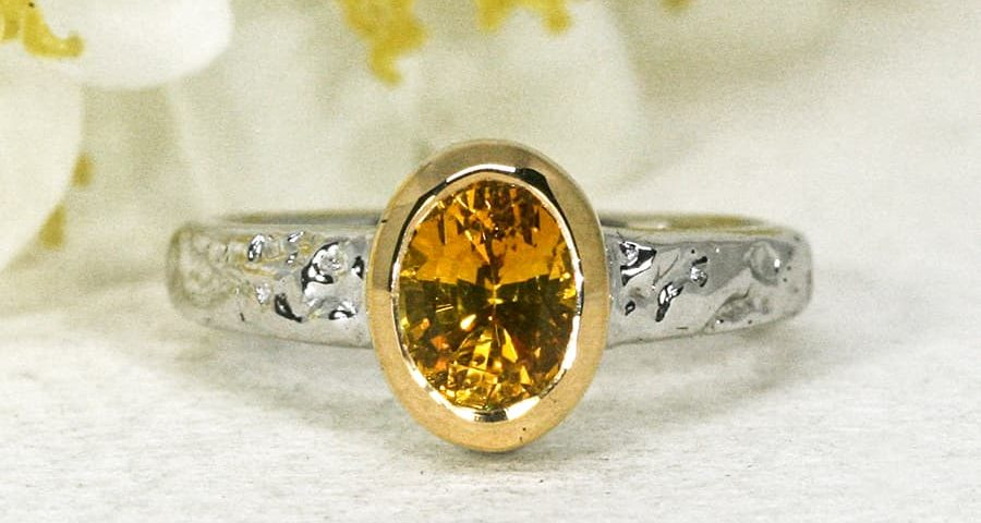 'Hot Summer Nights' 18ct white gold ring set with 1.47ct deep yellow oval sapphire john miller design