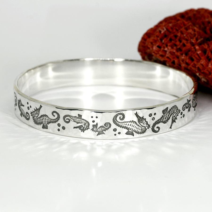 'Seahorse Swim' sterling silver seahorse bangle john miller design
