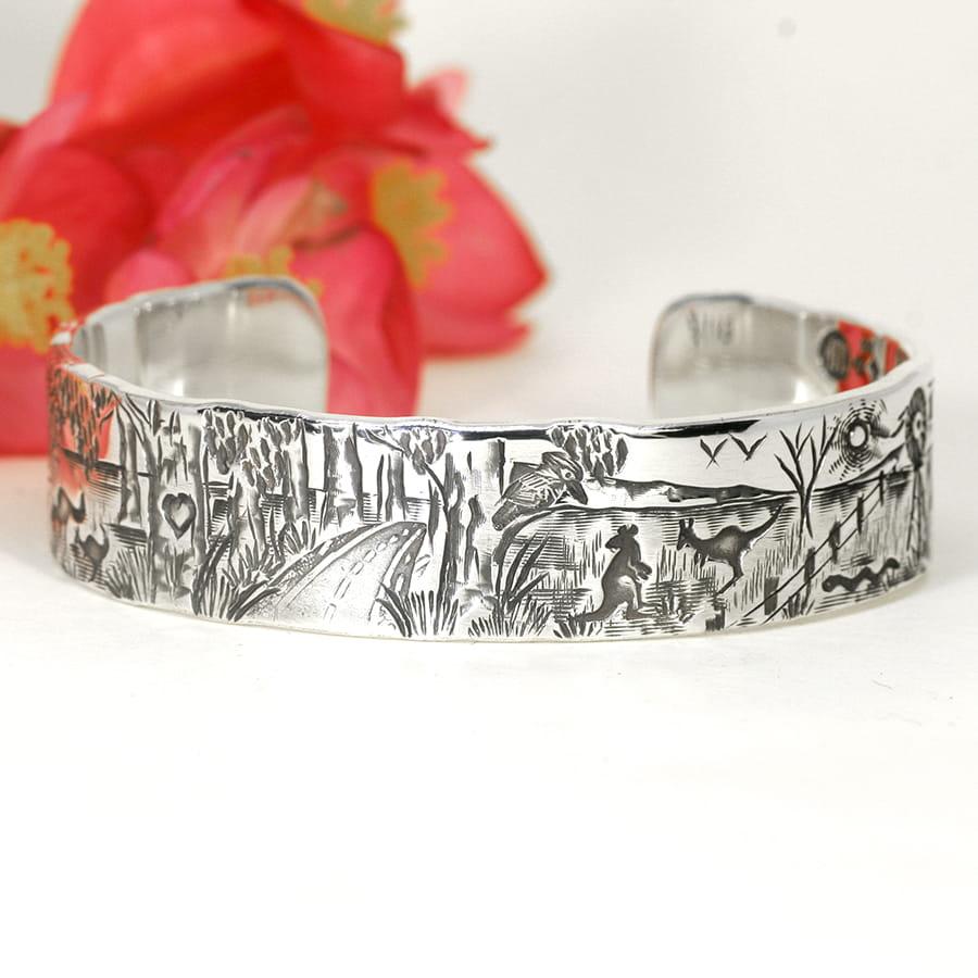 'Southwest Scene' sterling silver cuff featuring forest, aussie farming scene john miller design