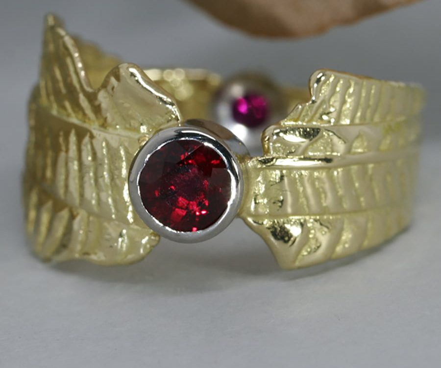 'Ruby Sunrise' 18ct gold patterned ring 2 Burma Rubies totalling 0.75ct set in 18ctwhite gold bezel john miller design