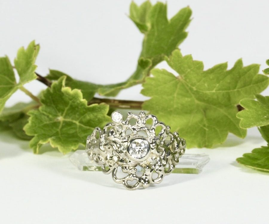 'Moon Six Pence' 18ct White gold fused welded set with 0.25ct GVS diamond 0.03ct GVS diamond