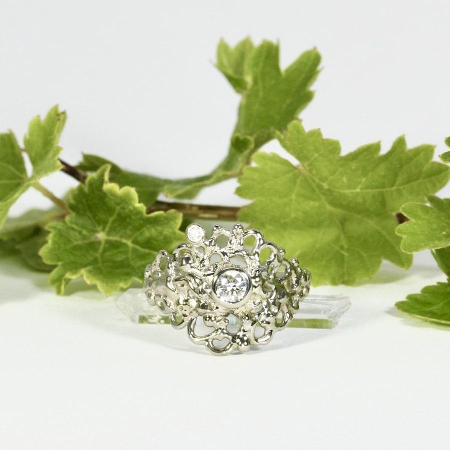 'Moon Six Pence' 18ct White gold fused welded set with 0.25ct GVS diamond 0.03ct GVS diamond